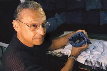 George Pollak holds a Mexican free-tailed bat in a cloth pouch