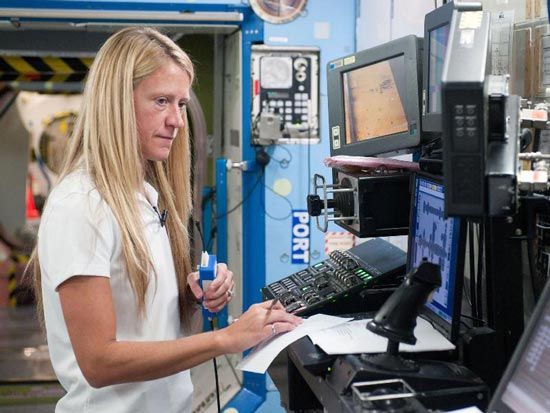Karen Nyberg, Expedition 36/37 flight engineer, participates in a routine operations training session in an International Space Station mock-up/trainer in the Space Vehicle Mock-up Facility at NASA
