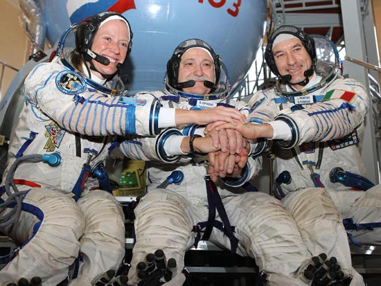 At the Gagarin Cosmonaut Training Center in Star City, Russia, Expedition 36/37 Flight Engineer Karen Nyberg of NASA (left), Soyuz Commander Fyodor Yurchikhin (center) and Flight Engineer Luca Parmitano of the European Space Agency clasp hands April 30 as they began final qualification training for their launch to the International Space Station. The three crew members will launch May 29, Kazakh time, in their Soyuz TMA-09M spacecraft from the Baikonur Cosmodrome in Kazakhstan for a 5 ½ month mission on the international outpost. Photo credit: NASA/Stephanie Stoll