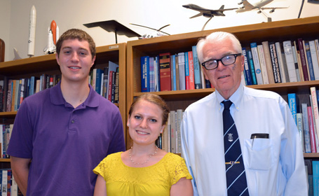 students Ryan Witte and Susanne Plaisted and Professor Hans Mark