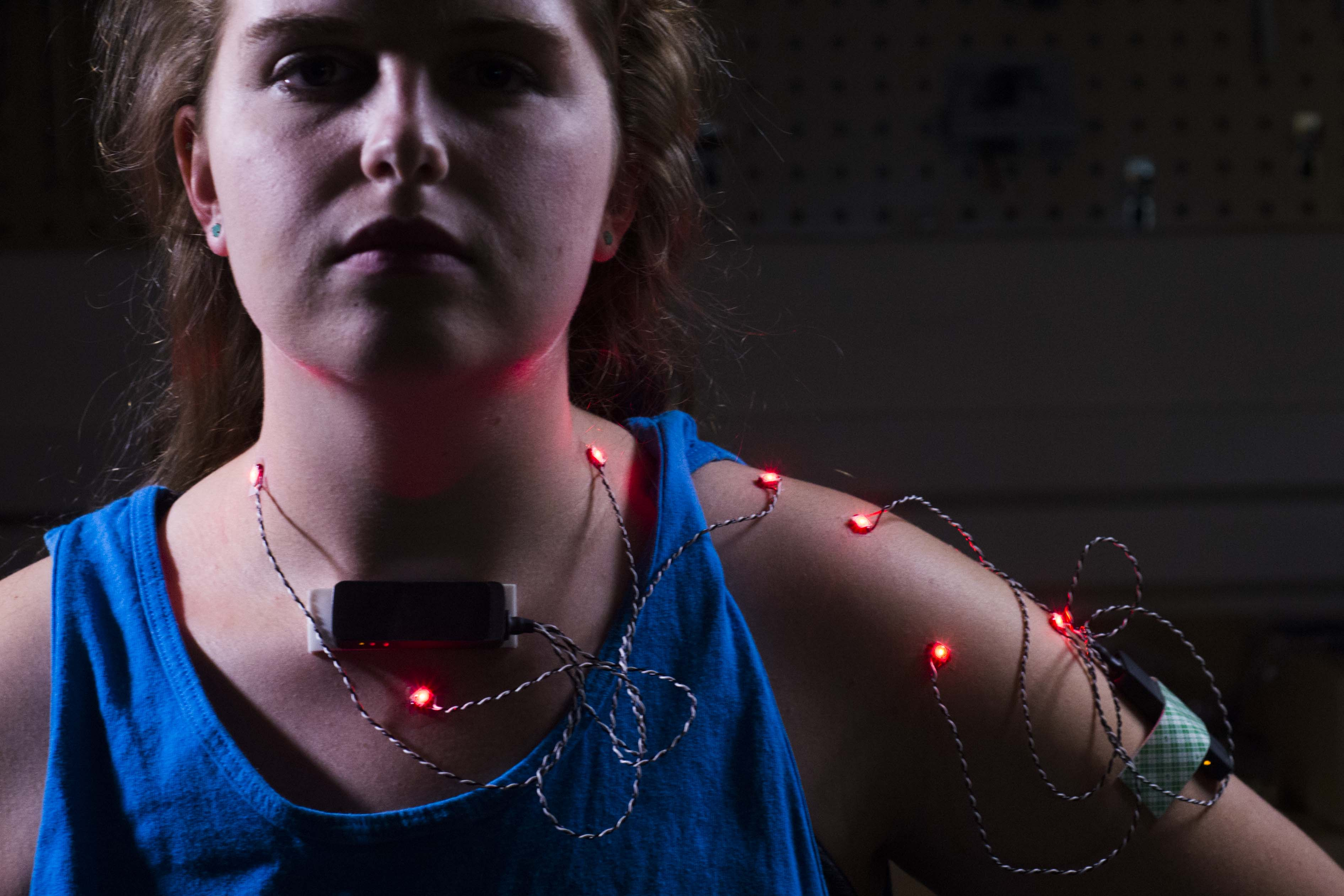 Engineering student Emma Nevendorff models sensors used to track shoulder motion