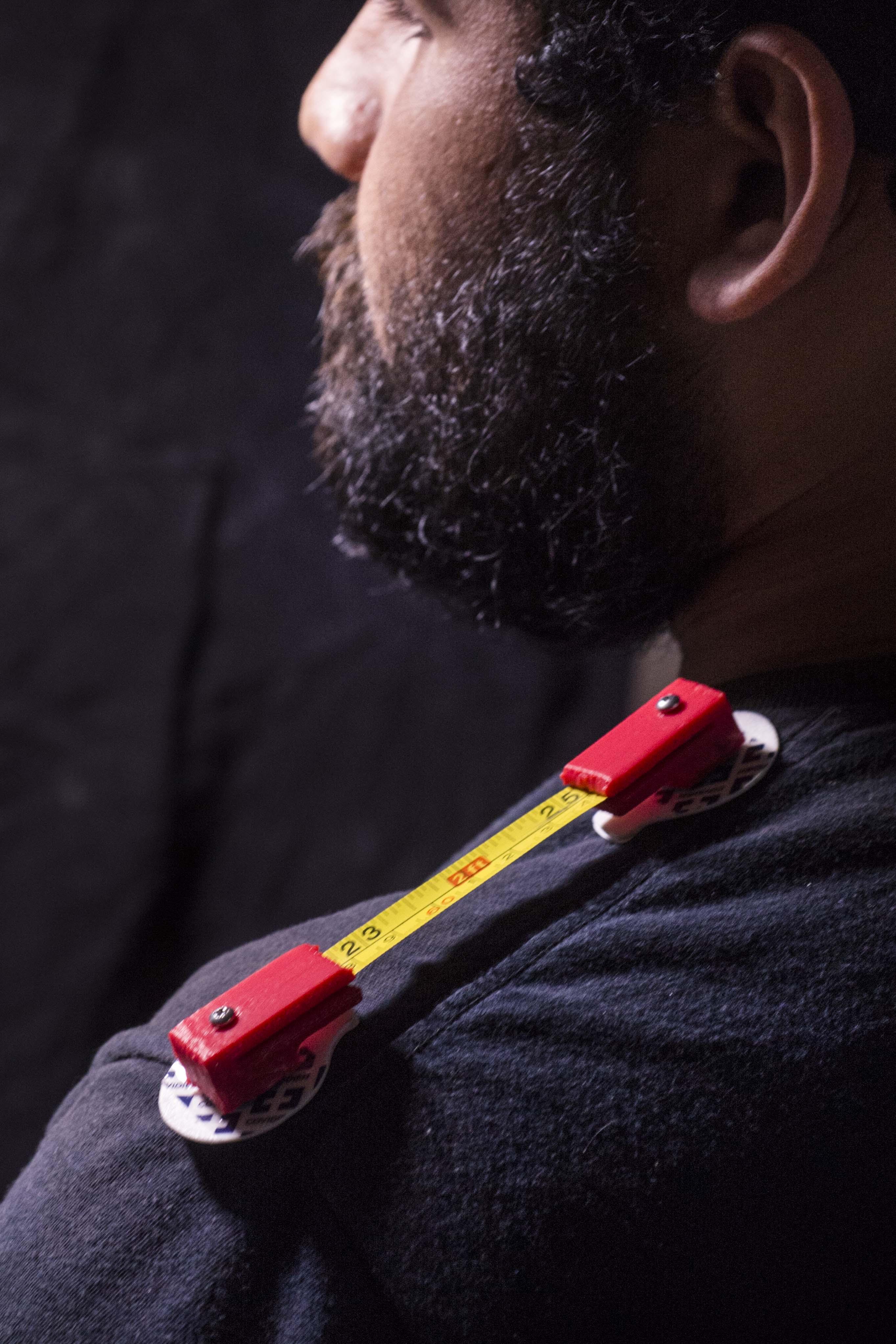 Jose Juan Mendez Jr., mechanical engineering senior, shows his invention that helps patients during shoulder rehabilitation