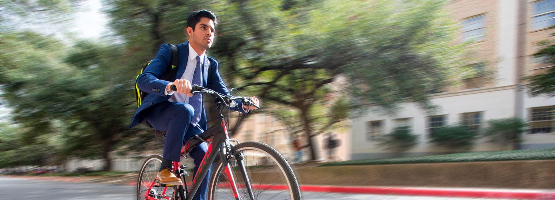 Karan Jerath riding his bike.