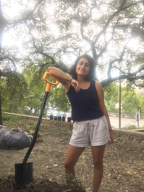 Joy Youwakim with shovel.